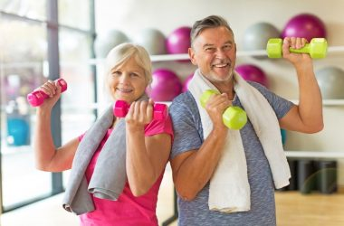 Smiling couple doing exercises for seniors to stay fit fight frailty