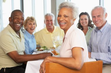 Group of seniors socializing with wine live longer and better