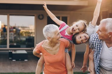 Carefree grandparents piggybacking grandkids because of Omni-Joint