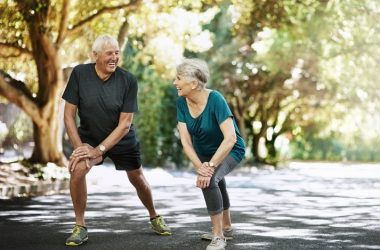 Senior couple doing stretches to stay limber and flexible