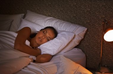 Woman sleeping with lamp on triggering insulin resistance