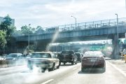Cars on highway spewing out exhaust contributing to air pollution