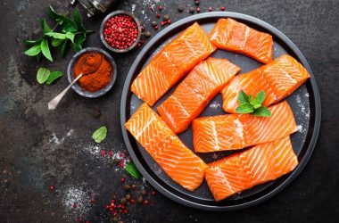 Fresh salmon fillets on a plate are a good example of healthy fatty fish