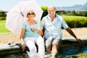 Smiling youthful senior couple splashing in fountain of youth will live longer