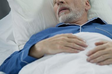 Senior man sleeping in bed keeps waking up gasping for air