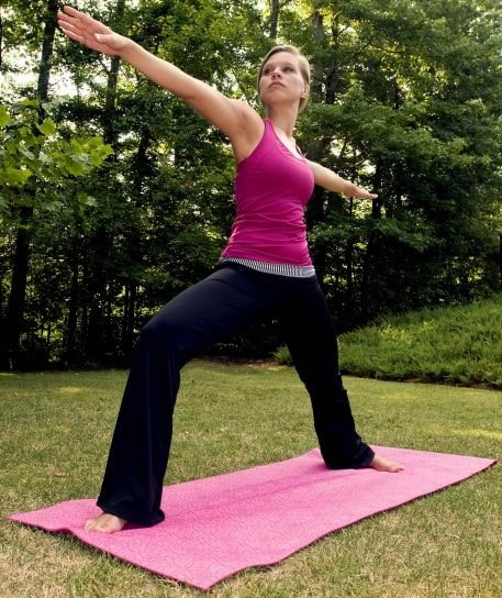 Yoga Woman performing Warrior II Pose.