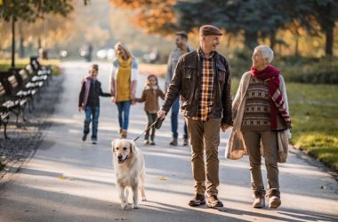 Senior couple walking dog and reducing high blood pressure
