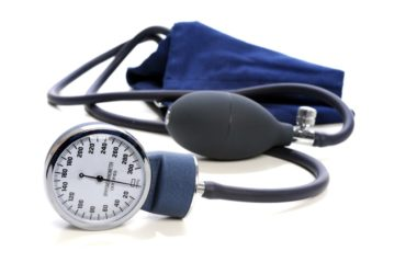 Blood pressure cuff to illustrate mild hypertension