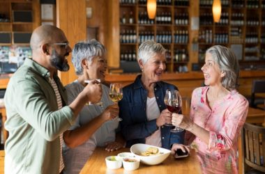 Happy friends having wine to reduce Alzheimer's and dementia risk