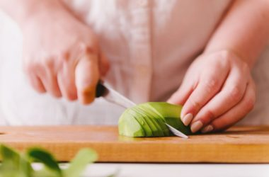 Close up of a woman cutting a magnesium and fiber rich avocado into slices