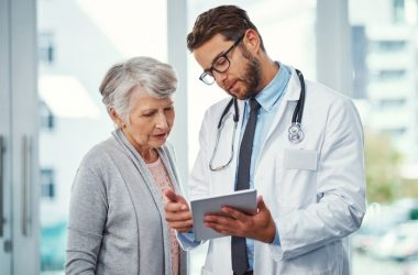 Doctor talking with patient who should run a background check on him