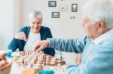 Happy senior couple playing chess has no cognitive decline