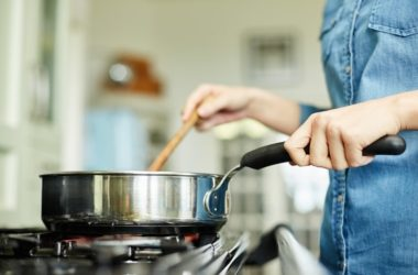Midsection image of woman cooking food in nonstick pan