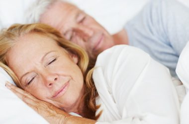 Senior couple in bed in deep sleep