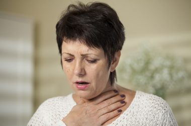 Woman with hand on chest has lung inflammation