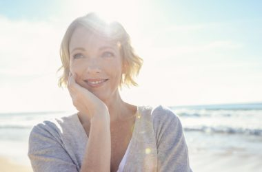 Beautiful mature woman on a beach in the sun may have low folate
