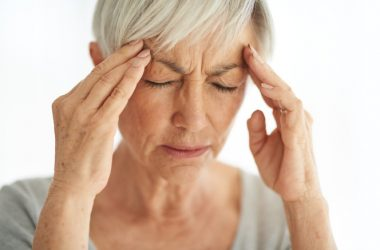 Senior woman suffering with migraine pain