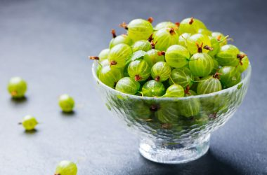 Indian gooseberry fruit in glass bowl can help fight cholesterol