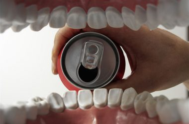 Shot from inside of mouth drinking sodas from a can