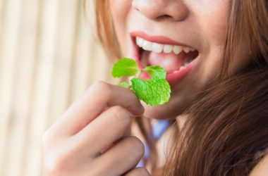 Woman eating spearmint leaves to fight cognitive decline