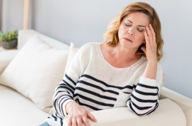 Woman suffering from inactive ingredients side effects