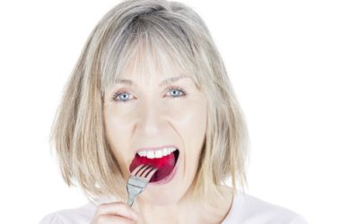 Woman with high blood pressures eats beet to neutralize salt in her diet