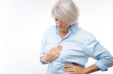 Woman having acid reflux or heartburn needs fast relief