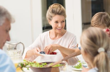 Happy senior woman fighting off depression with Mediterranean diet food