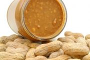 Peanut butter in a jar sitting on peanuts to test sense of smell