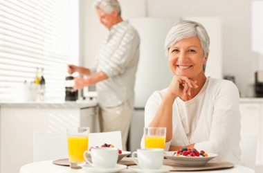 Senior couple having orange juice with breakfast