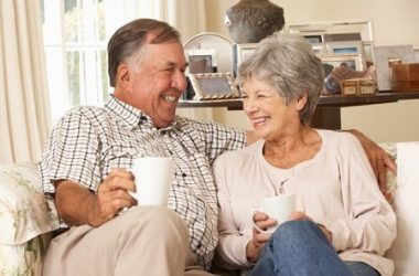 Senior couple sitting on sofa enjoying a cup of Alzheimer's fighting tea