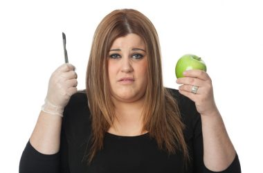 Woman tries to decide between weight loss surgery or diet
