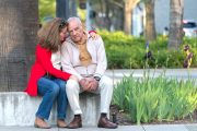 Senior man worried about dementia sits with daughter