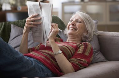 Senior woman who has reversed aging doing a crossword puzzle