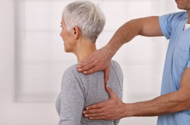 Senior woman receiving chiropractic care for pain