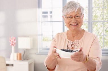 Senior woman with a bowl of polyphenol rich berries to clean her arteries