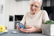 Senior woman with healthy beta cells checking blood sugar