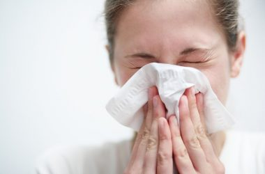 Woman blowing nose considers taking decongestants