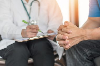 Male patient meeting with doctor about prostate cancer treatment