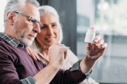 Senior couple looks at statins bottle given for prostate cancer prevention