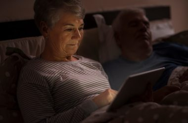 Senior woman using her blue light emitting tablet is rising accelerated aging