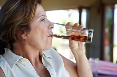 Attractive mature woman drinking soda linked to broken bones