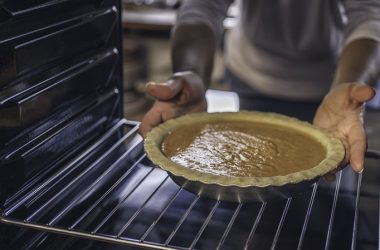 Baking pumpkin pie for the holidays in the oven
