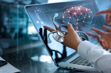 Doctor looks at brain on computer screen to illustrate reversing brain age