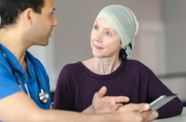 Woman with breast cancer meeting with doctor