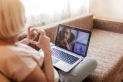 Girl talking to her grandmother with diabetes on video chat during quarantine