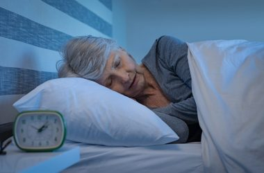 Senior woman in bed sleeping to reduce her diabetes risk