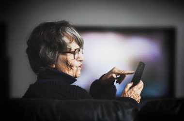 Senior woman watching too much TV hardening her arteries