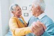 Senior couple dancing for exercise to reduce hospital admission risk