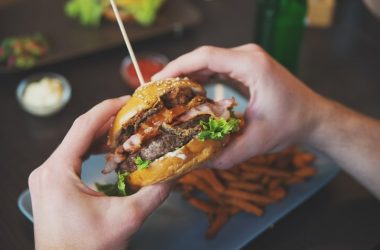 Man eating burger and french fries raising his dementia risk